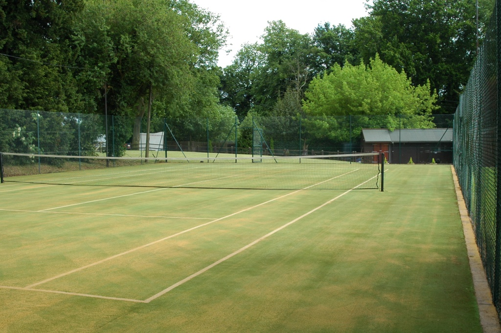 Artificial Grass Tennis Court With Moss Removed